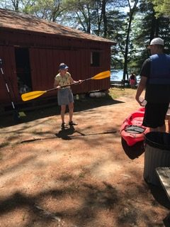 Linda giving my husband & son a Kayaking lesson