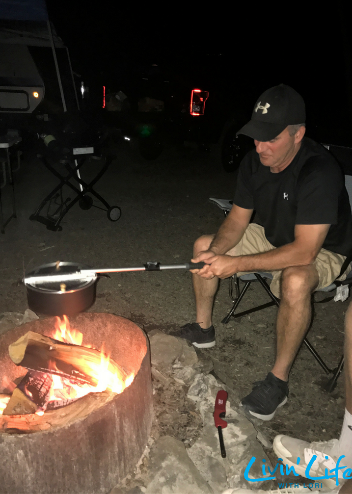 Hubby popping the pop corn over the fire