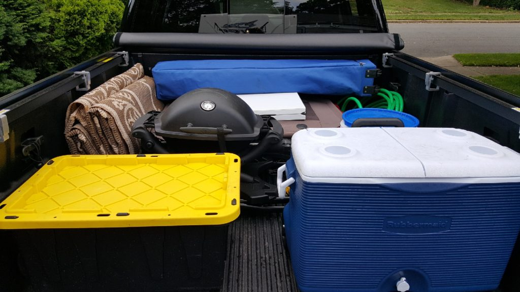 organize your camping cooler and accessories in back of the truck
