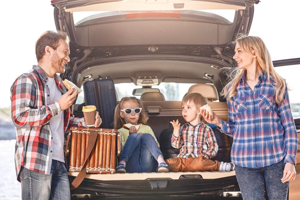 family stopping for roadside picnic