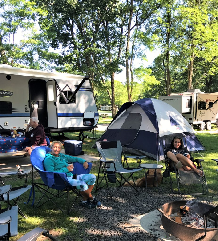 Family RV Camping At A Campground