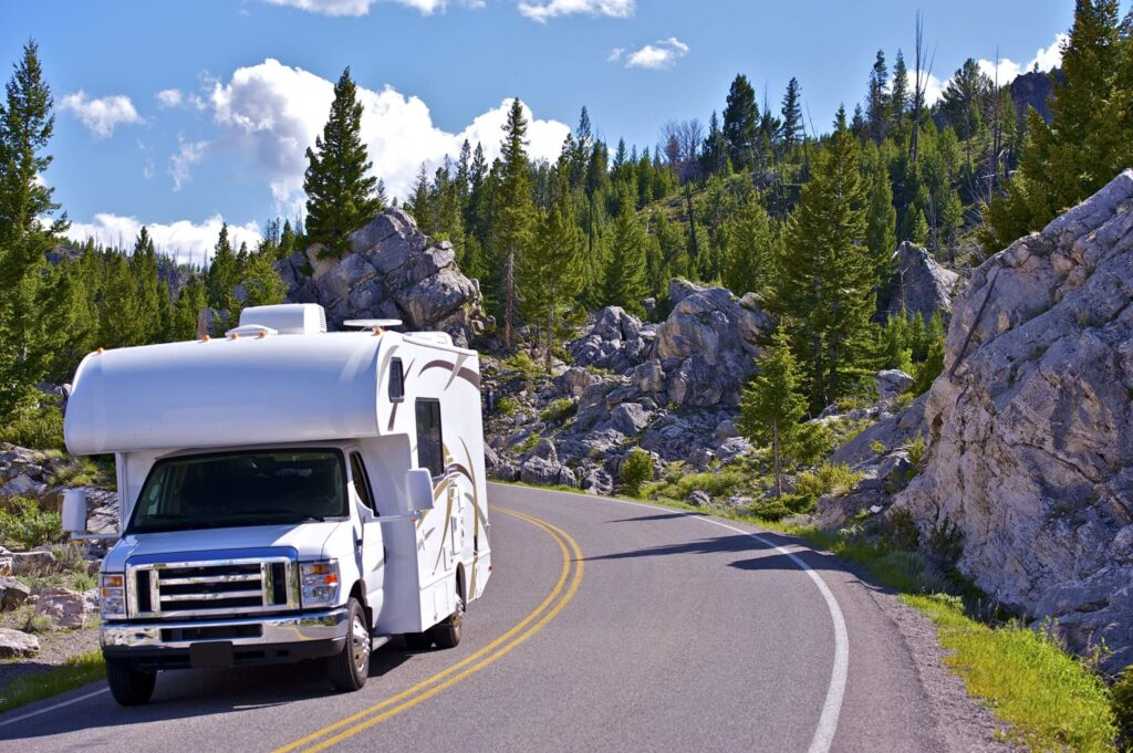 RV camper driving down the road