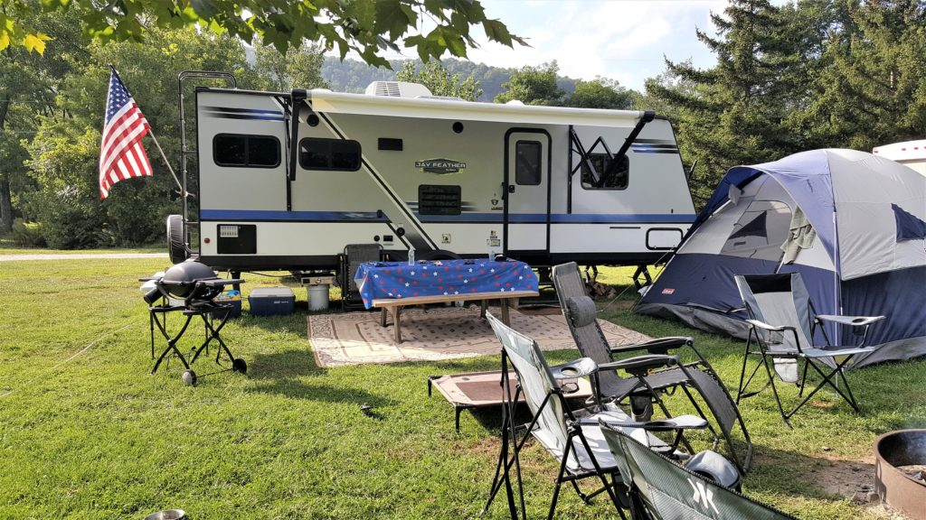 RV Campground set up with travel trailer and tent