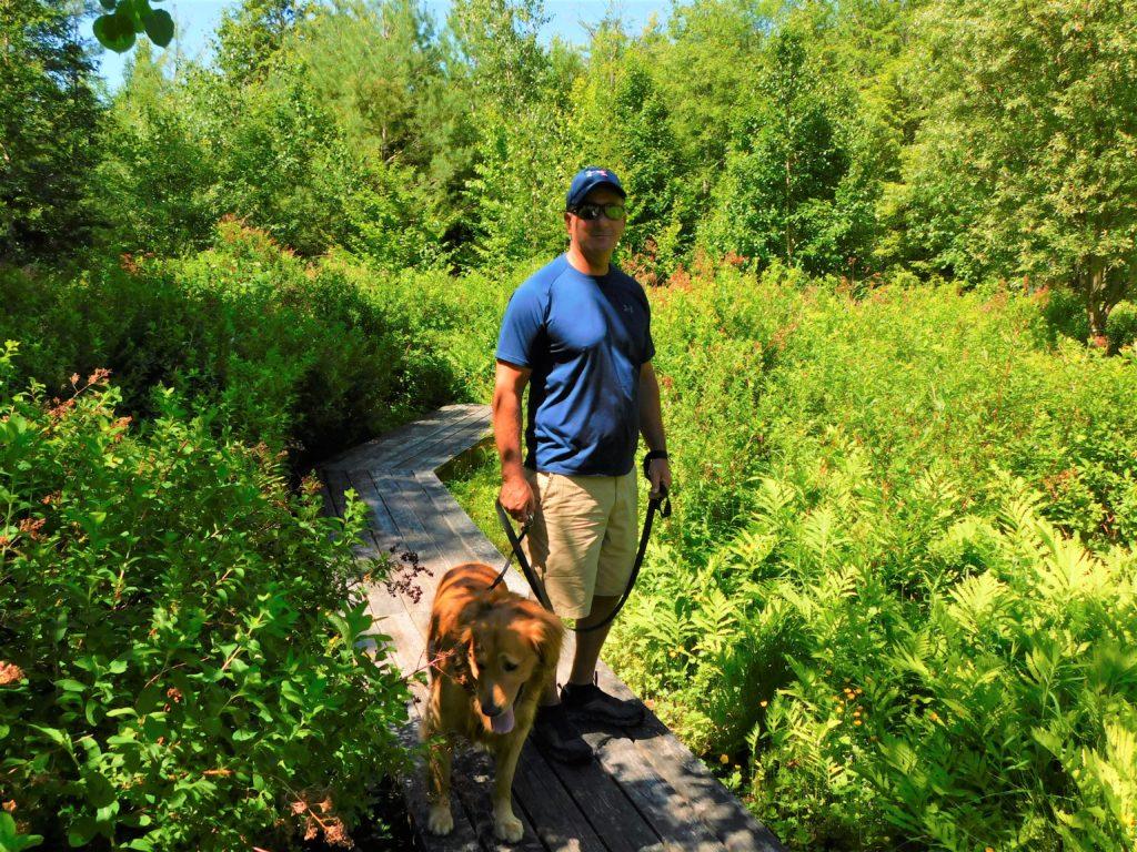 walking with golden retriever at Mountaintop Arboretum