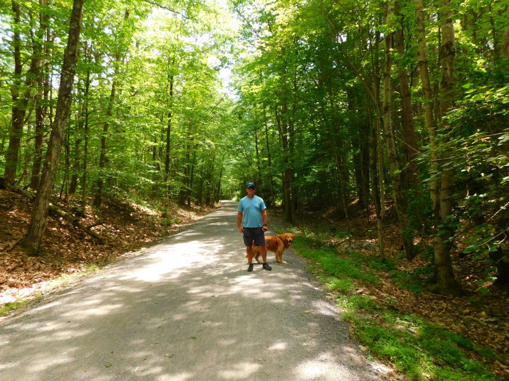 walking with golden retriever on Ashokan Rail Trail