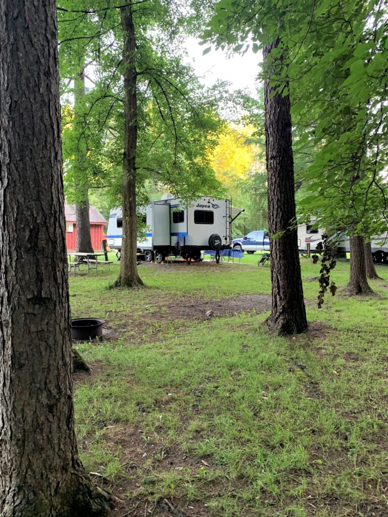 RV site from the wooded trail at the KOA