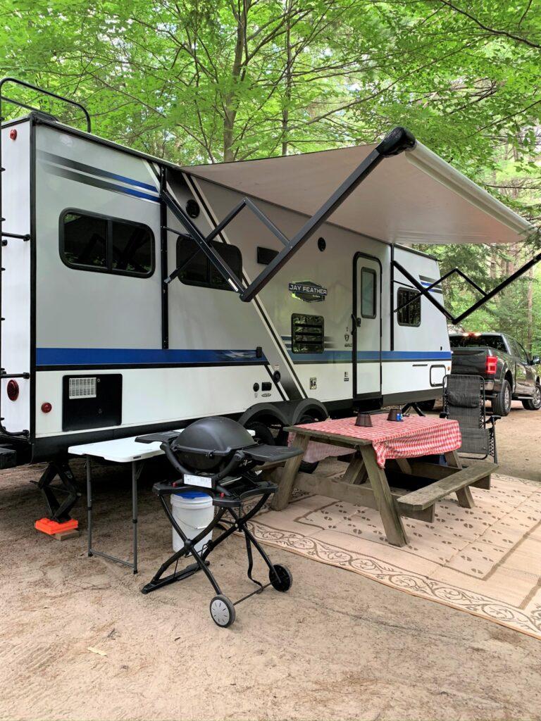travel trailer set up at Adirondack Camping Village Lake George