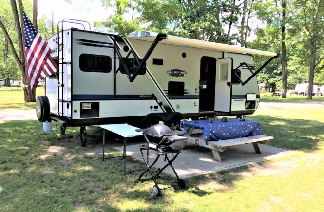 travel trailer set up at campground