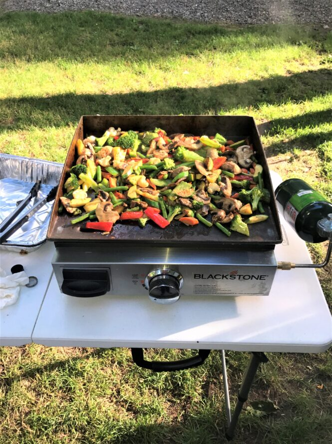 vegetables cooking on the Blackstone Griddle